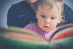 Baby and book
